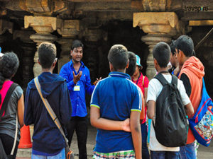 listening to stories of hampi on the heritage tour