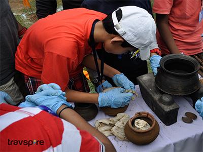 digging up artifacts during mock excavation